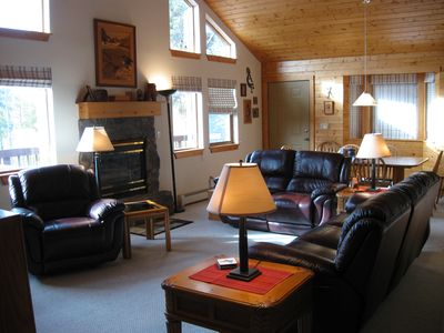 Great room with leather furniture.  Very open & bright