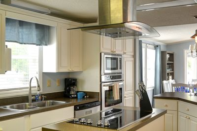 Large well-equipped kitchen.
