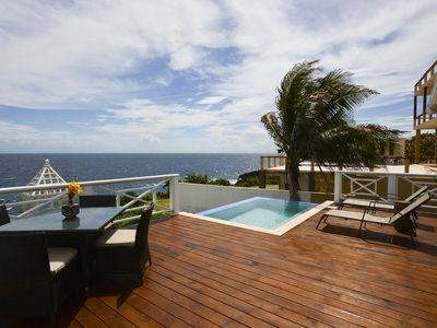 Photo for Oceanfront house with pool. 5 mins from West Bay Beach.