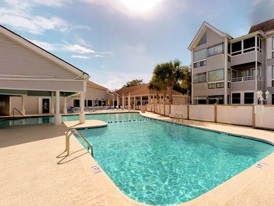 Photo for NEW LISTING! Spacious condo w/ shared pool and balcony, steps from the beach!