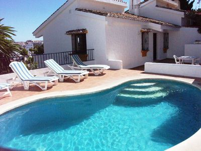 Photo for Enchanting villa with private pool and stunning views, close to beach.