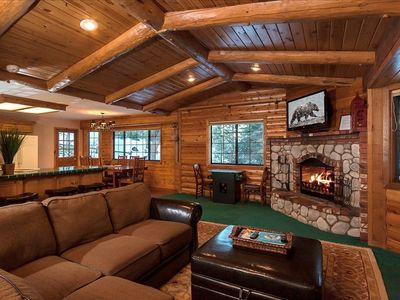 Beautiful Open Concept Living Area with LCD TV over Log Fireplace