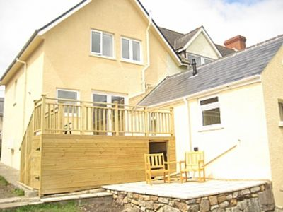 Photo for Elevated position, deck with stunning Views to the sea. 10 minute walk to beach.
