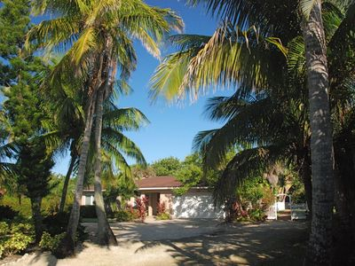 Photo for Beautiful remodeled 4 bdrm private home + 2 bdrm cottage steps to the Gulf