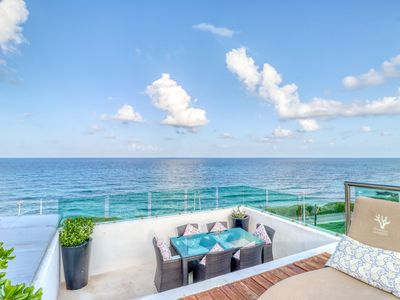 Photo for Waterfront getaway w/ a rooftop infinity pool, private balcony, & kitchen