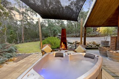 Outdoor spa and fireplace.