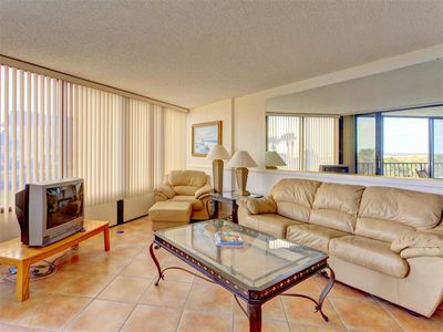 Enjoy the views from our spacious living room! - Cool tile floors and natural hues invite you to take it easy in our spacious living room. Relax and enjoy the views!