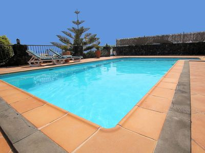Photo for Luxury 3 bed villa with h/pool h/tub free WiFi & full A/C.A short walk to beach