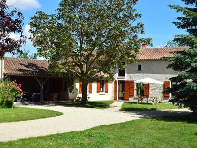 Photo for 18th century farmhouse with spacious covered terrace, nearby Poitiers and Chinon