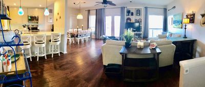 Open living, dining and kitchen, Balcony. Sweeping views of lake.