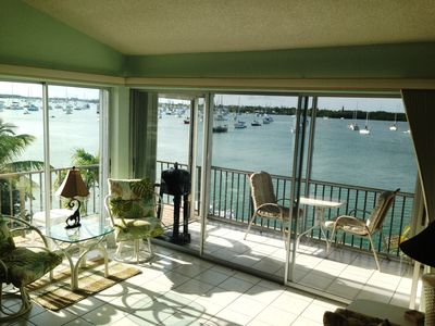WRAP AROUND WATER VIEW WITH INSIDE & OUTSIDE BALCONY- OVERLOOKS THE POOL & DOCKS