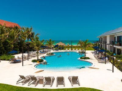 Photo for New Luxury Beach front resort! Suite 101, King bed, Queen sleeper, full kitchen!