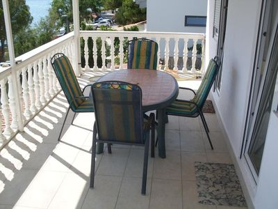 Photo for Two bedroom apartment with terrace and sea view Tisno, Murter (A-15895-c)