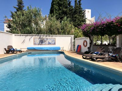 Relaxing at Casa da Figueira's large heated private pool is enjoyable all day.