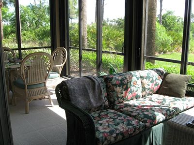 Glass enclosed lanai with sliding doors for year round comfort