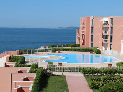 Photo for Studio cabin facing the sea with terrace, swimming pool, private parking