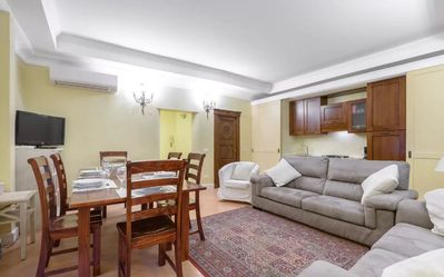 Main living room with kitchen. Vacation rental apartment #residenzasinibaldi