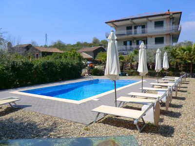 Photo for Holiday home on the slope of Mount Etna with pool between orange and lemon trees