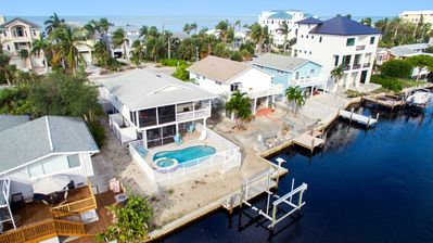 Photo for Newly Renovated! 3-Bed & 3-Bath Waterfront Beach Home with Heated Pool & Spa