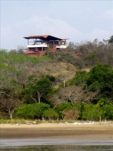 House inserted into the hill. To be outside but protected from the tropical sun