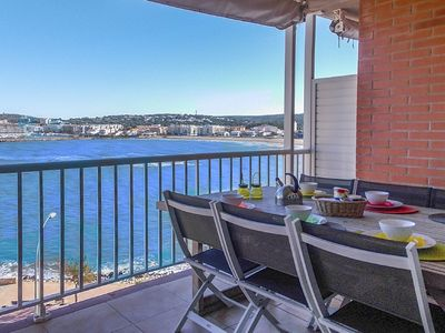 Photo for Fantastic seafront duplex apartment with shared swimming pool in L'Escala