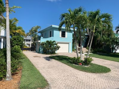 Photo for Adorable canal front cottage close to beach with boat ramp, dock and pool.