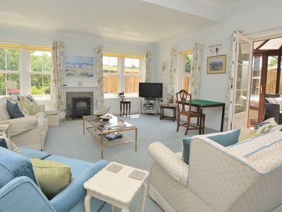 Relax in the bright and airy lounge overlooking the pretty garden