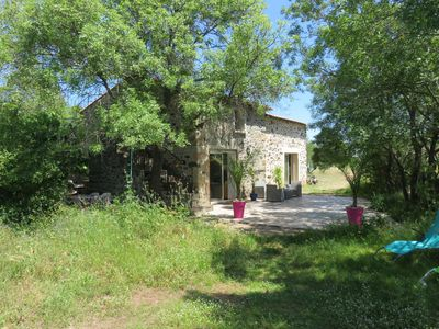 Photo for Renovated stone farmhouse on wooded ground near lake salagou in the hérault