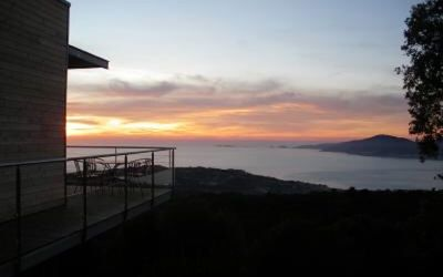 Photo for Wooden lodge on piles nestled in the scrubland,view over the Bay of Ajaccio