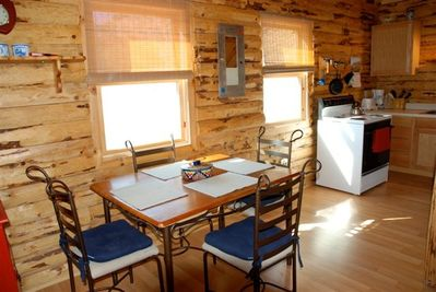 Dining area near the fully equipped kitchen
