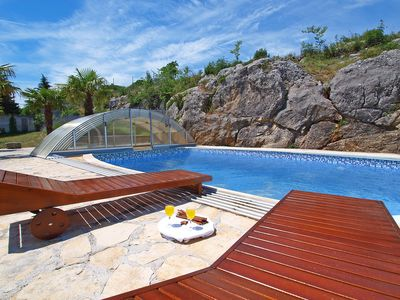 Photo for This 3-bedroom villa for up to 6 guests is located in Drniš/Drnis and has a private swimming pool, a