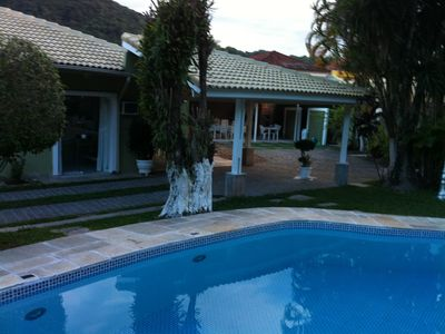 Photo for Nice house - 02 blocks from the beach- with large pool and barbecue