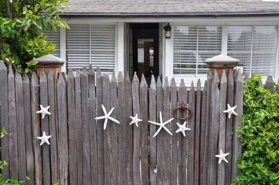 A starfish gate welcomes you to Sharing Gates by the Sea!