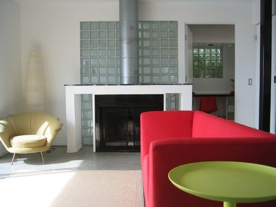 living area  with real fireplace & office