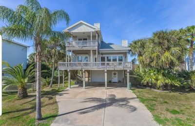 Large luxury beach-side home in Pirates Beach with short walk to beach.