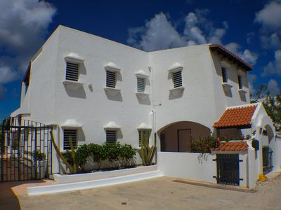 Front side of the villa, with 2 off road parking places places.