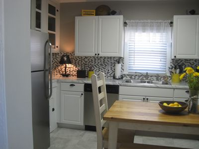 Eat in kitchen is fully equipped and cheerfully decorated. Accommodates 6-8.