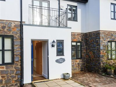 Photo for In a very desirable location in the centre of Abersoch, this splendid contemporary three storey hous