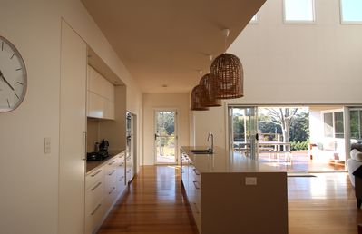 Kitchen leading out to undercover verandah