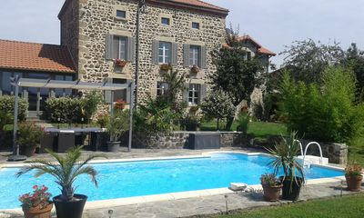 Photo for Beautiful  stone house , heated pool,1 hectare of land. Family friendly,local