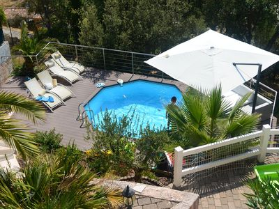 Photo for NEAR THE BEACH OF SAINT AYGULF WITH AN AMAZING VIEW OF FREJUS
