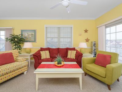 Photo for Unique, festive 3-bedroom luxury condo with adorable coastal decor and free WiFi located downtown on the bayside and just two blocks to the beach and Boardwalk!
