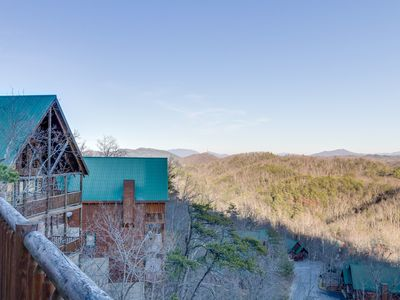 Photo for Charming log cabin w/amazing mountains views, shared pool, & private hot tub