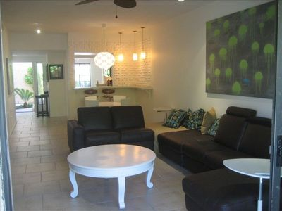 Photo for **** OASIS Resort Remodeled Modern Condo with 8 POOLS, 9 hot tubs & tennis! ****