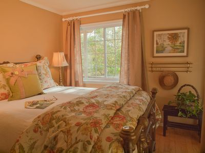 Lovely second bedroom with queen bed, lake view and doors leading out onto deck.