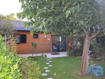 Photo for Wooden house on the ground floor, quiet with private flower garden of 300 m2.