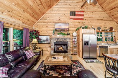 Snuggle up by a warm fire in this open-concept home.