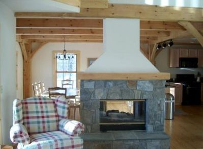 Living room looking at double sided fireplace located on the main level