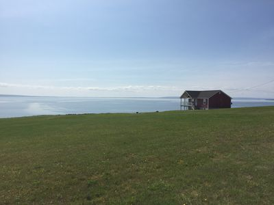 Spectacular view of house and Bras D'Or lakes across property