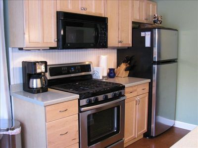 Well-equipped kitchen with many basics in pantry